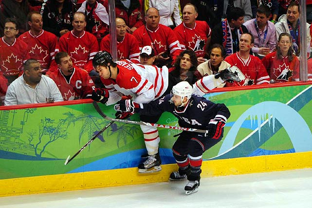 American forward Ryan Callahan hits defenseman Brent Seabrook in the second period as the U.S. continued throwing the puck in and forechecking.
