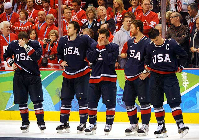 (Left to right) Americans Tim Gleason, Erik Johnson, Zach Parise, Ryan Malone and Jamie Langenbrunner stand dejected after losing a hard-fought battle with Canada.