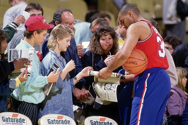 Barkley signs autographs for fans before a 76ers game against the Los Angeles Lakers in December 1987. Although Barkley had one of his best statistical seasons, Philadelphia struggled that year, going 36-46 and missing the playoffs.