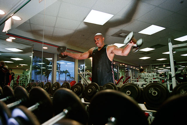 Barkley lifts weights in a gym.