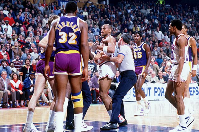 Barkley has to be restrained as he gets into an altercation with Kurt Rambis during a February 1986 game against the Los Angeles Lakers.