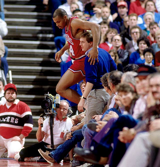 Barkley gives a quick hug to a fan after diving into the stands during a game against the Portland Trail Blazers in January 1988. Barkley posted a career-high scoring average with 28.3 points per game in the 1987-88 season, including 37 points in this loss to the Trail Blazers.