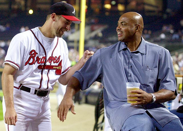 Atlanta Braves closer John Smolts enjoys a laugh with Barkley before a game against the Philadelphia Phillies in Atlanta in October 2001.
