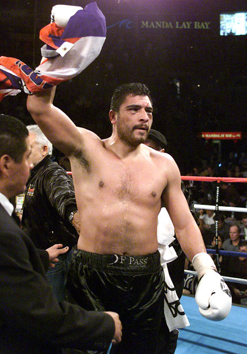 John Ruiz becomes the first Hispanic heavyweight champion after beating Evander Holyfield for the WBA heavyweight title.