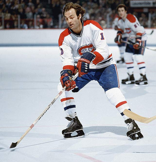 Montreal's Guy LaFleur scores his 1000th career point.