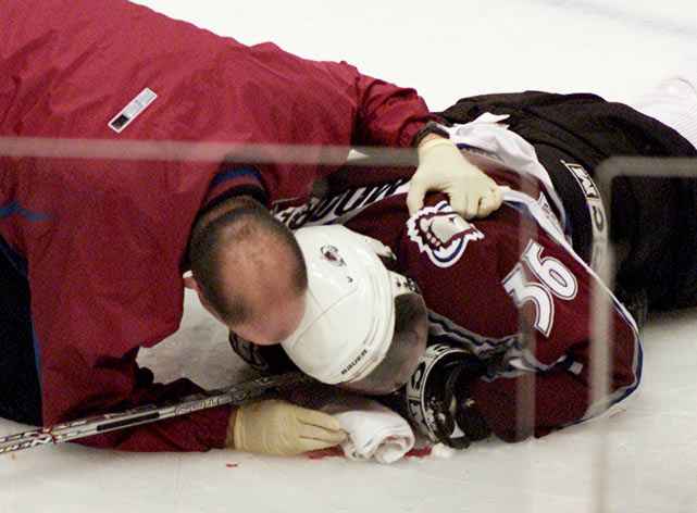 Vancouver's Todd Bertuzzi hits Colorado's Steve Moore  in the side of the head from behind and drove his head into the ice. Moore landed face-first with Bertuzzi on top of him. Moore suffered a broken neck, a concussion and deep cuts on his face.