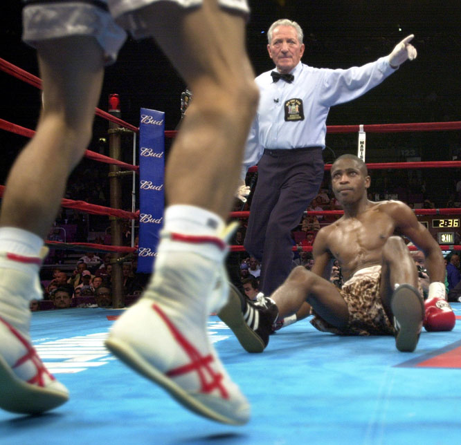 Mercante was 81 for his last title fight: Lopez's eighth-round stoppage of Petelo (right) at Madison Square Garden.