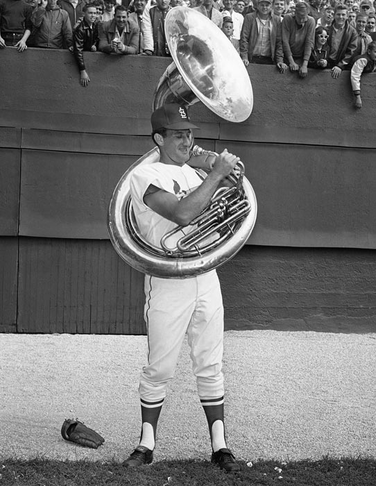 On Wednesday, baseball legend Bob Uecker, 75, announced that he was going to be sidelined 10-12 weeks due to heart surgery. Here are some classic shots of Mr. Baseball on and off the diamond.  Uecker brushes up on his sousaphone skills before the second game of the 1964 World Series between St. Louis and the Yankees.