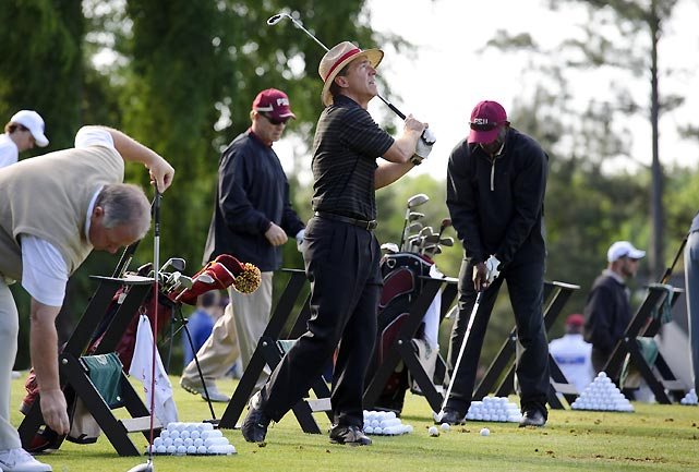 "From left: Jim Grobe, Jimbo Fisher, Nick Saban and Terrell Buckley prepare for the event. While they're playing for charity, Houston Nutt admits it's hard for the coaches to dial down their competitive spirit once they hit the course. ""It's a fun time. It's great fellowship time, but as the [tournament] day gets here, it gets a little more competitive,"" he said."