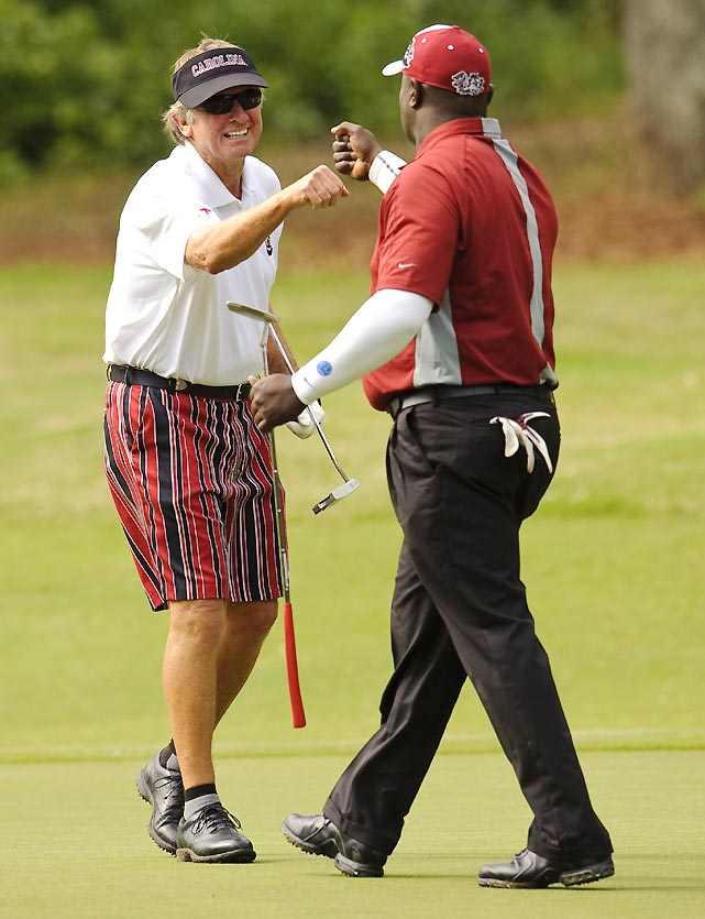 Steve Spurrier (left) and former Gamecocks and Packers wide receiver Sterling Sharpe had their sights on a third straight title, but would finish in third, two strokes off the lead.