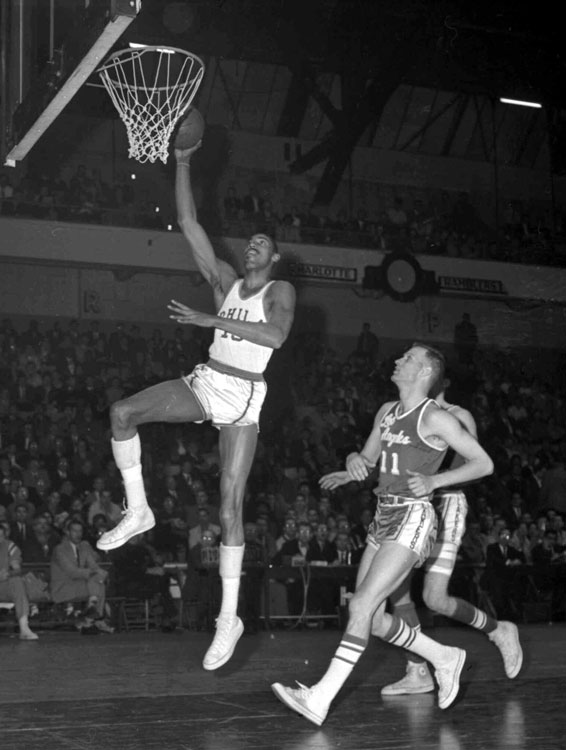 "A four-time winner of the MVP award, Wilt ""the Stilt"" won the award three consecutive years in the late '60s. In 1966-67, the big man also finished third in the NBA in assists (7.8), while still leading the league in points (33.5) and rebounds (24.6) and leading Philly to the NBA title."