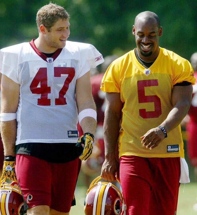 McNabb and his new tight end, Chris Cooley, share a laugh during Redskins training camp in Ashburn, Va.