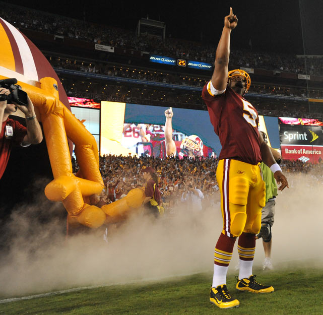 McNabb soaks in the applause after being introduced to the home crowd before his Redskins debut against Dallas. McNabb would throw for 171 yards in Washington's 13-7 victory.