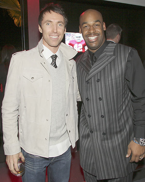 McNabb poses with Steve Nash during the Ronnie Lott and Donovan McNabb Dinner at the Audi Forum in Phoenix.