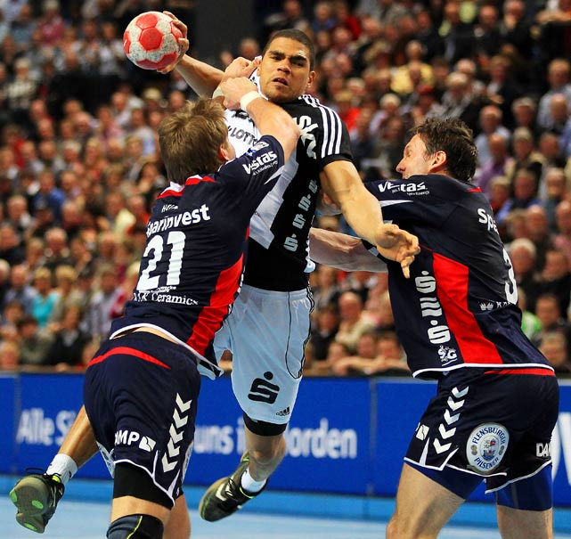Daniel Narcisse of THW Kiel challenges Jacob Heinl and Tobias Karlsson of SG Flensburg-Handewitt for the ball during their Toyota Handball Bundesliga match on April 7 in Kiel, Germany.