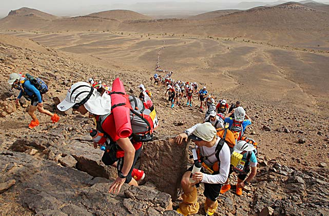 Competitors take part in the second stage of the 150-mile Marathon des Sables in Morocco on April 5. Participants must carry all their equipment on their backs during the six-day race. Organizers provide only nine liters of water and open-sided local tents daily.