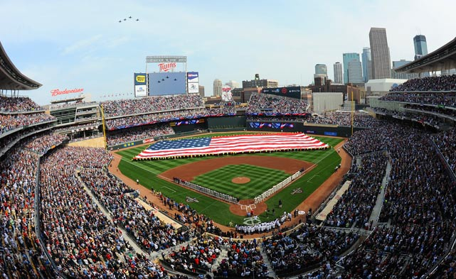 Construction workers who helped build the new Target Field unfurl a huge American flag during the National Anthem before the Minnesota Twins' home opener on April 12 against the Boston Red Sox. The Twins won, 5-2.