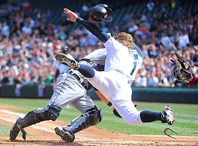Seattle Mariners' left fielder Eric Byrnes is tagged out at home by Detroit Tigers catcher Alex Avila in the second inning of their game on April 18 in Seattle, Washington. Byrnes was thrown out at home while attempting to score on a single by teammate Casey Kotchman.