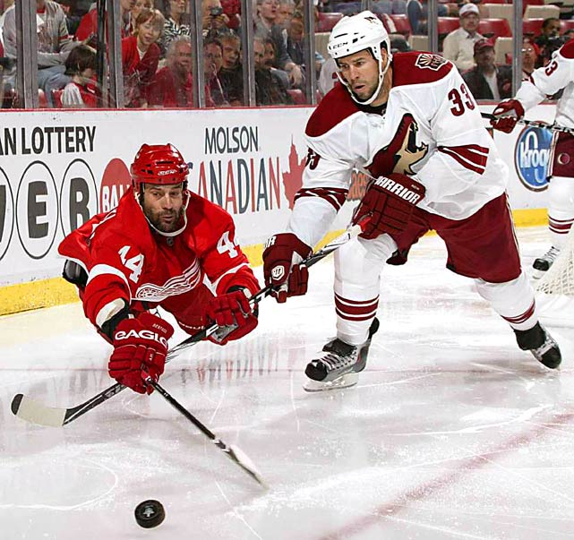 Phoenix Coyotes defenseman Adrian Aucoin battles right wing Todd Bertuzzi of the Detroit Red Wings for possession of the puck during Game 3 of their playoff series. The Coyotes beat the Red Wings, 4-2, at Joe Louis Arena on April 18 to take a 2-1 lead in the series.