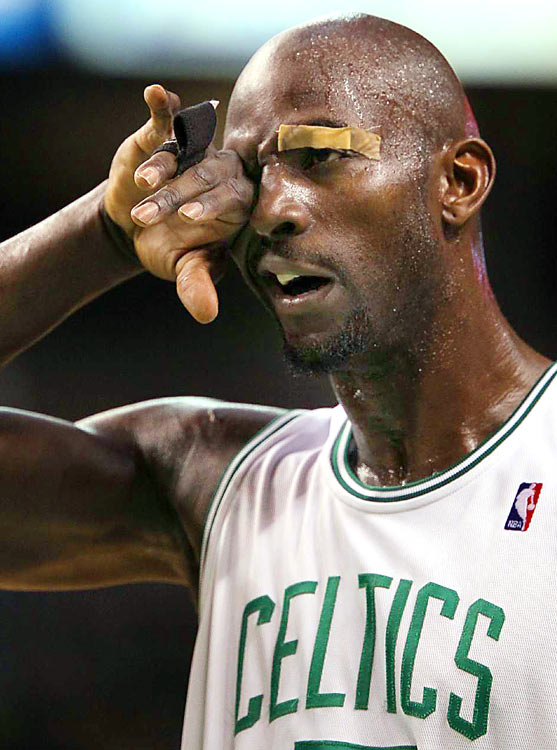 Banged-up Boston Celtics forward Kevin Garnett wipes sweat from his eye during his first round playoff game against the Miami Heat on April 17 at TD Banknorth Garden in Boston. The Celtics beat the Heat, 85-76.