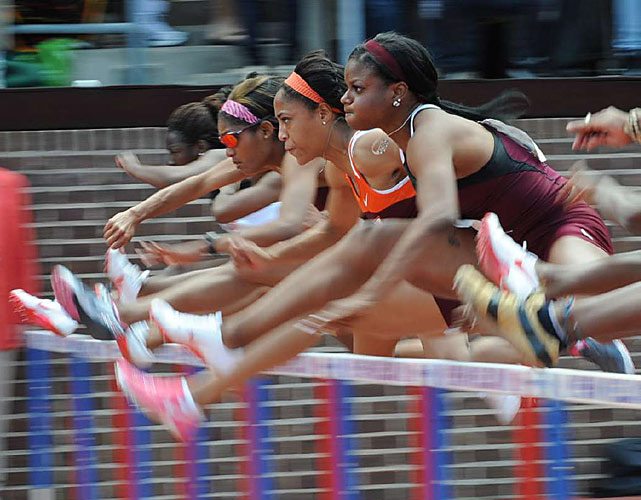 Queen Quedith Harrison of Virginia Tech (orange headband) won the 100-meter hurdles at the Penn Relays with a time of 12.61 seconds.