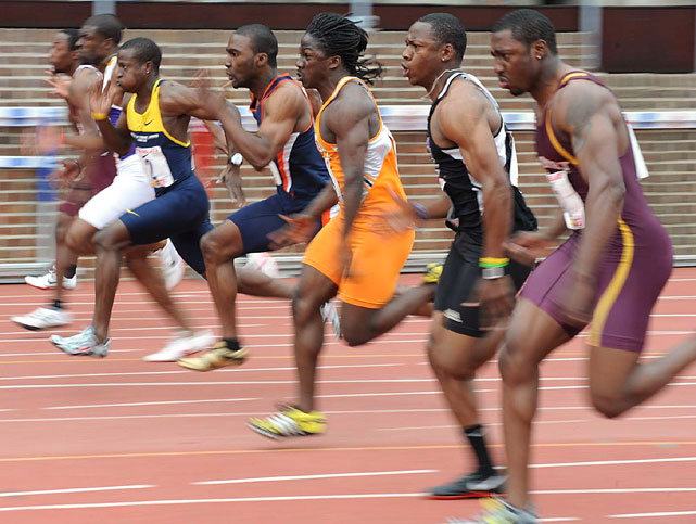 Competitors race in the 100m dash at the Penn Relays April 24 in Philadelphia. The event was won by Kimmari Roach (yellow and blue) of Jamaica's University of Technology in a time of 10.34  seconds.