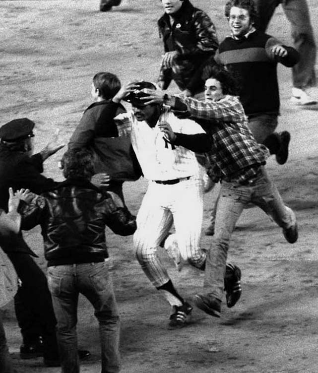 Chris Chambliss' leadoff homer off Kansas City's Mark Littell in the bottom of the ninth of Game 5 of the 1976 ALCS snapped a 6-6 tie and ended New York's 12-year pennant drought. Chambliss needed a police escort to reach home plate after pandemonium broke out at Yankee Stadium.