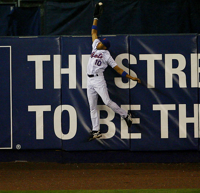 Mets left fielder Endy Chavez made quite possibly the most unbelievable catch in postseason history. Chavez perfectly timed his leap and reached far over the wall to rob Scott Rolen of a go-ahead home run in the sixth inning of Game 7 of he 2006 NLCS, sending Shea Stadium into a frenzy. Unfortunately, the catch couldn't prevent the Cardinals from advancing.