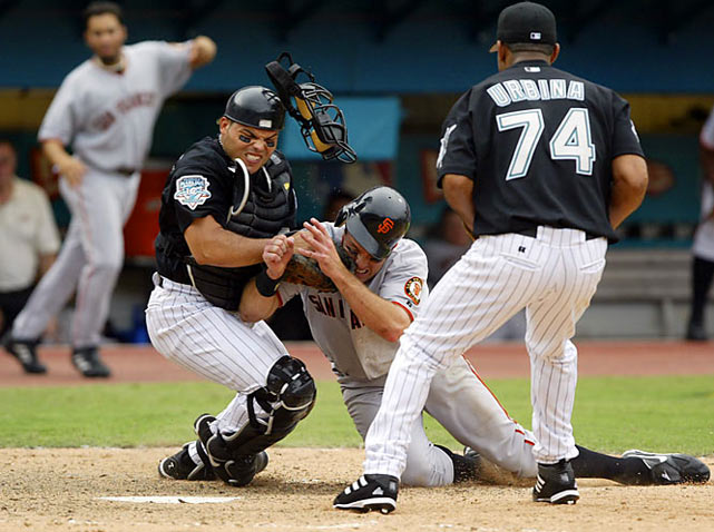 Florida's Ivan Rodriguez hung onto the ball as San Francisco's J.T. Snow barreled over him in Game 4 of the 2003 NLDS, marking the first time a postseason series ended with the potential tying run thrown out at the plate.