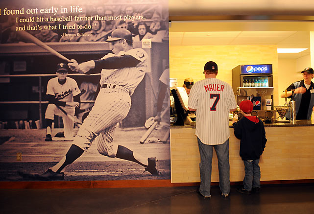 A giant image of Minnesota Twins Hall of Famer Harmon Killebrew greets customers next to one of the concession stands on the club level.