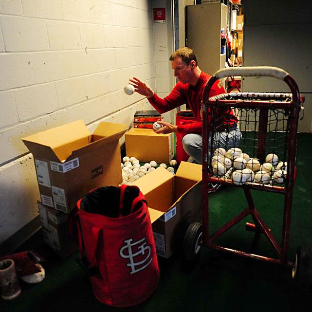St. Louis Cardinals batting practice pitcher Dennis Schutzenhofer gets balls ready prior to the game at Great American Ballpark.