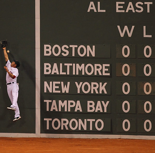 Boston left fielder Jacoby Ellsbury can't reach Robinson Cano's fourth-inning hit at Fenway Park on Opening Night.