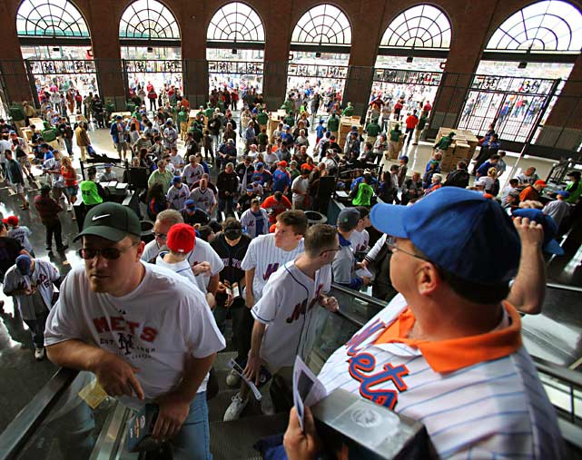 Mets fans enter Citi Field prior to the opener versus the Florida Marlins.