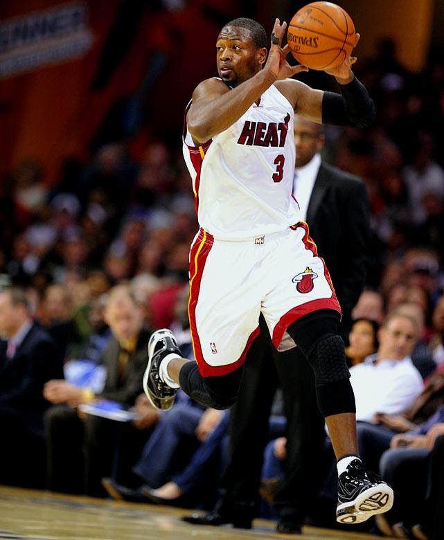 Dwyane Wade not only is posting his usual big numbers, but he's also part of a Heat team that is vying with Orlando and Cleveland to be the league's top field-goal defense.