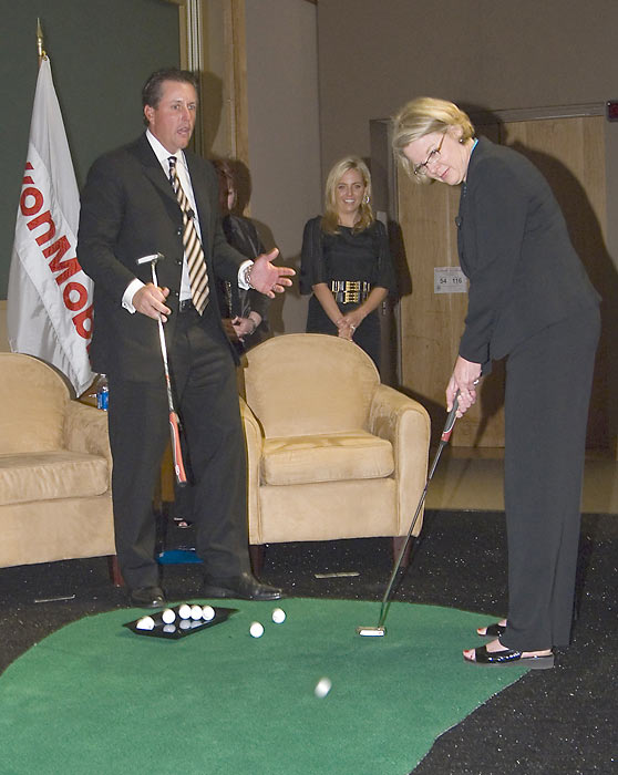 Mickelson looks on as Education Secretary Margaret Spellings putts a golf ball during a town hall meeting sponsored by the Mickelson ExxonMobil Teachers Academy.