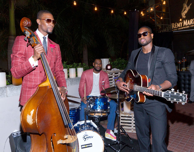 James joins Chris Bosh and Dwyane Wade at a Miami performing arts center to celebrate Bosh's 28th birthday in March 2012. No word on whether this newly formed band performed any songs for the audience.