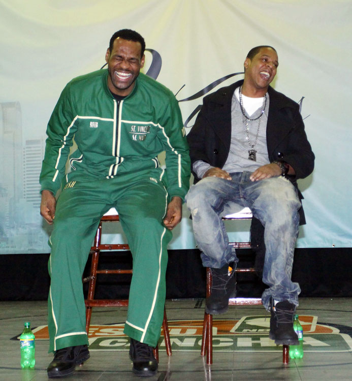 James, decked out in warm-ups of his high school alma mater, enjoys a chuckle with Jay-Z during the 2010 All-Star Weekend in Dallas.