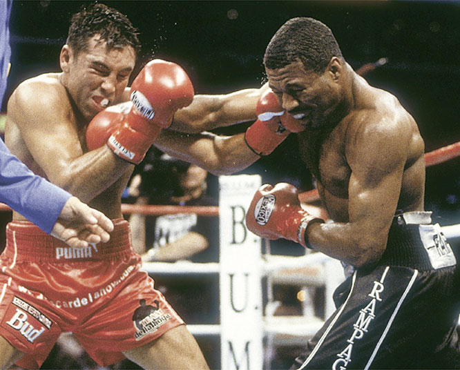 Mosley made nine successful defenses of the IBF lightweight title before moving up two divisions to face De La Hoya for the WBC welterweight championship. After 12 back-and-forth rounds, Mosley emerged with a split-decision victory.
