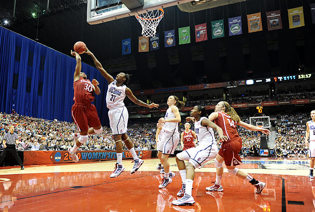 Tina Charles (right) helped energize the Huskies on the defensive front with 11 rebounds and six blocked shots.