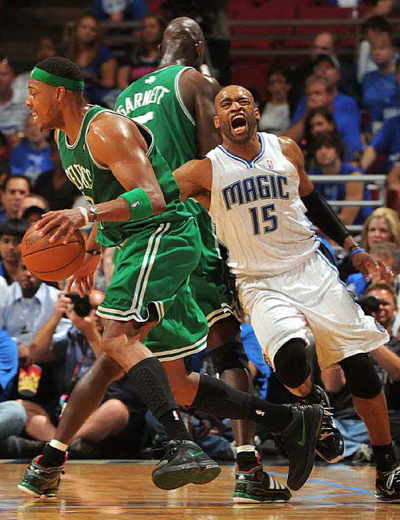 Orlando's Vince Carter gets his right arm caught in a tangle with Boston's Kevin Garnett, who set a pick for Paul Pierce during Game 1 of the Eastern Conference Finals on May 16. The visiting Celtics won 92-88.