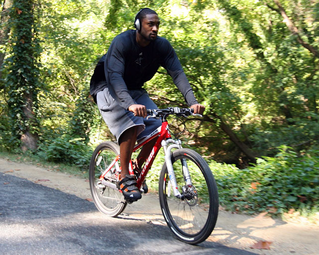 Wizards guard Gilbert Arenas listens to tunes while riding to a 2007 practice.