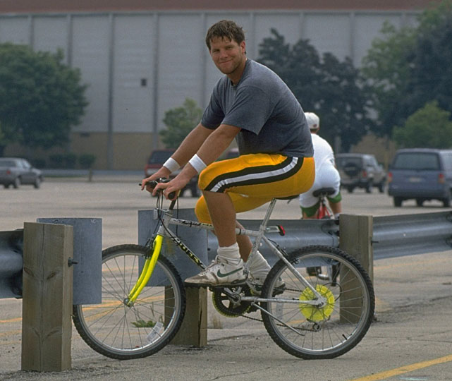 Brett Favre is all smiles while riding through the Packers training facility in July 1993.