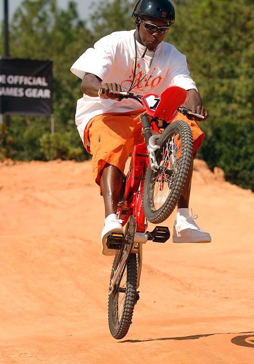 The former Chad Ochocinco rides a BMX bike on a dirt track at the Disney-MGM Studios in Lake Buena Vista, Fla.