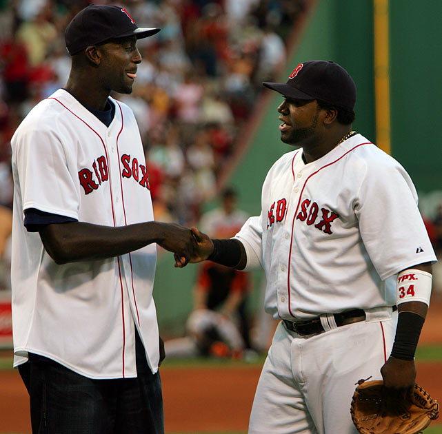 A day after being traded to the Celtics, Kevin Garnett reconnected with his old Minnesota buddy David Ortiz after throwing out the first pitch at Fenway Park.