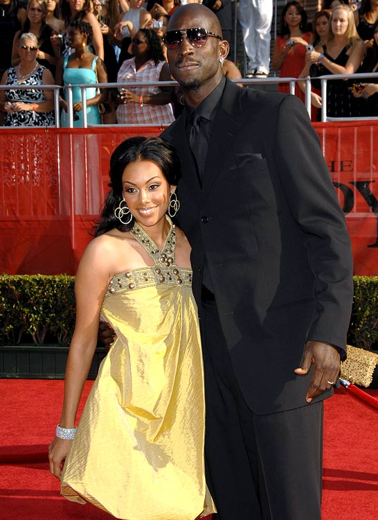 Garnett poses with his wife, Brandi. The couple married in 2004, which forced KG to miss a chance to defend the gold medal in Athens.