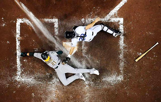 Tampa Bay Rays catcher John Jaso is late with the tag as Oakland Athletics outfielder Ryan Sweeney blurs the 3rd base chalk line and is safe on a sacrifice fly to center by Gabe Gross in the third inning of their game at Tropicana Field on April 27 in St. Petersburg, Florida. Tampa Bay defeated Oakland 8-6.