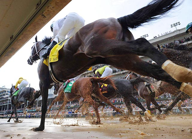Super Saver runs close to the rail the first time around the sloppy track during the Kentucky Derby. Super Saver was one of four horses saddled by trainer Todd Pletcher, who won his first Derby after saddling 24 previous horses.