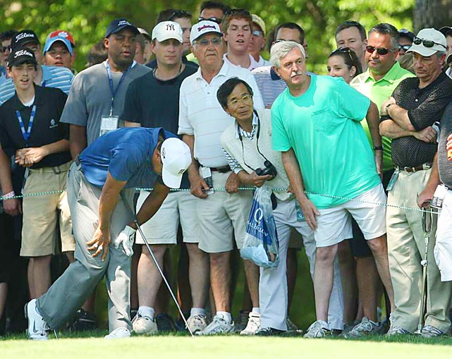 Fans watch as Tiger Woods reacts to a poor shot on the tenth hole during the second round of the 2010 Quail Hollow Championship at the Quail Hollow Club on April 30 in Charlotte, North Carolina. Tiger missed the cut and did not play on the weekend.