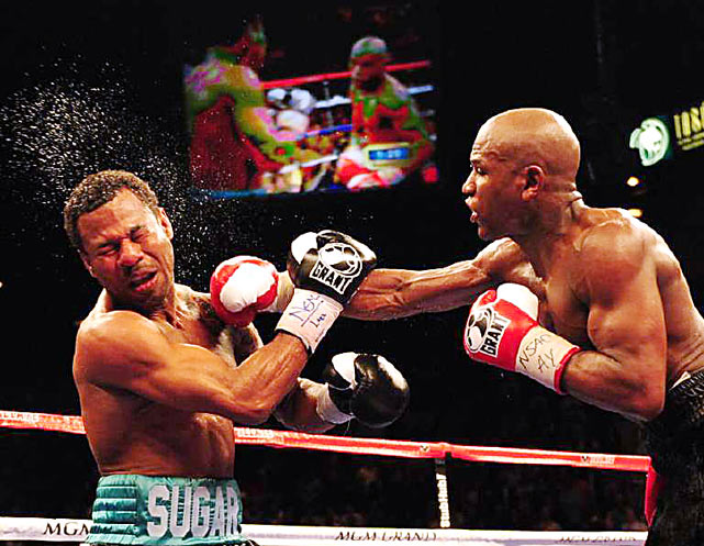 Floyd Mayweather connects with a right to the head of Shane Mosley during their welterweight bout at the MGM Grand in Las Vegas on Saturday. Mayweather won in a unanimous decision.