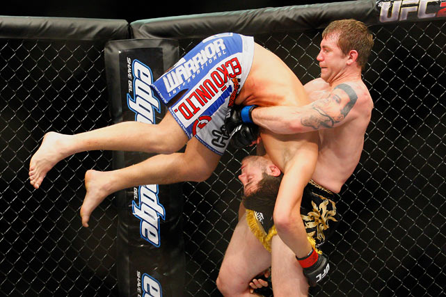 Alan Belcher lifts Patrick Cote on his way to winning their middleweight bout at UFC 113 at the Bell Centre on May 8 in Montreal.